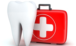 Model of a tooth next to a first-aid kit