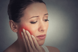 woman with jaw pain
