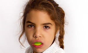 young girl with mouthguard in