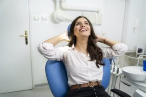 Woman smiling and relaxing in dental chair